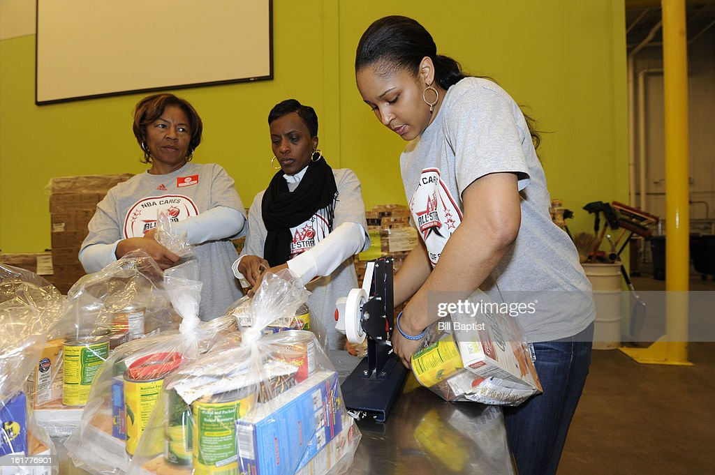 Star Maya Moore of the Minnesota Lynx helps out at the 2013 NBA Cares Day of Service at the Food Bank sorting on February 15, 2013 in Houston, Texas.