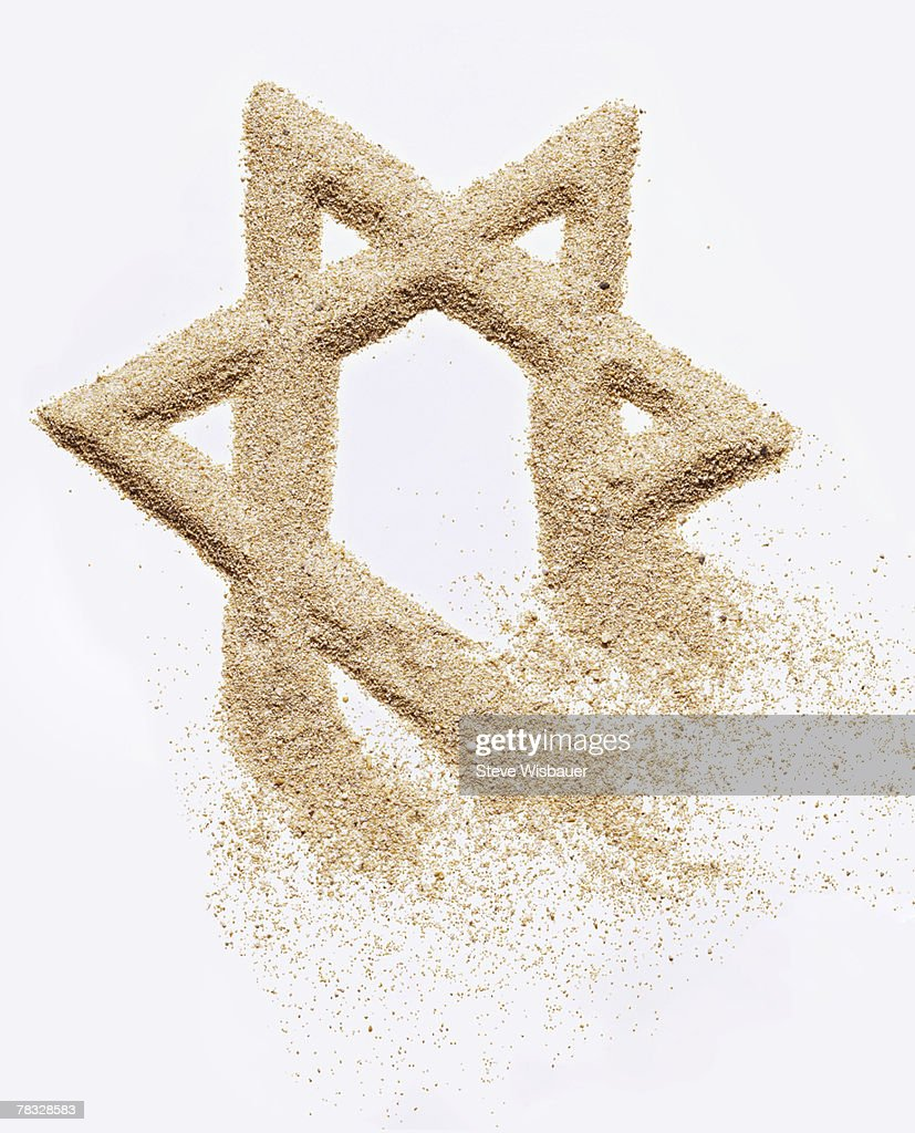 Star of David created in sand : Stock Photo