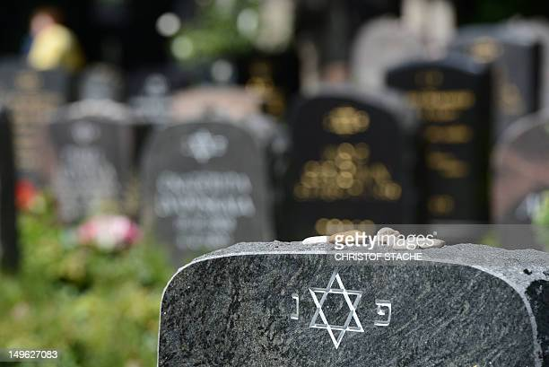 A star of David on a gravestone can be seen at the Jewish cemetery in Berlin Weissensee on August 1 2012 Berlin is seeking to have the KarlMarxAlle...