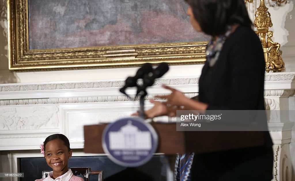 Star of the film Beasts of the Southern Wild Quvenzhane Wallis (L) listens as U.S. first lady <a gi-track='captionPersonalityLinkClicked' href=/galleries/search?phrase=Michelle+Obama&family=editorial&specificpeople=2528864 ng-click='$event.stopPropagation()'>Michelle Obama</a> (R) speaks during an interactive student workshop at the State Dining Room of the White House February 13, 2013 in Washington, DC. The first lady hosted middle and high school students from the DC area and New Orleans to participate in the event.