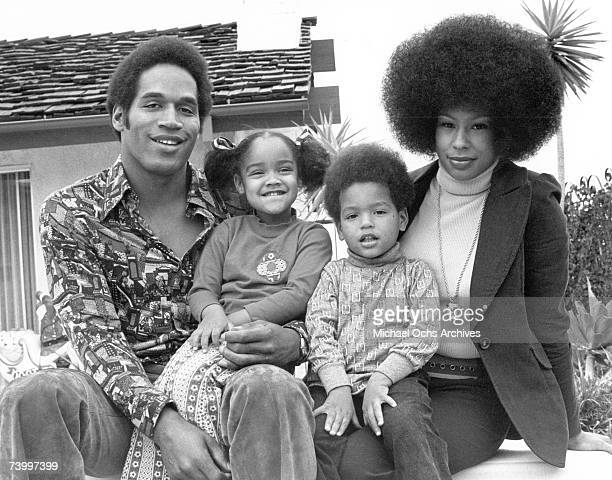 NFL star OJ Simspson poses for a portrait with his wife Marguerite Simpson daughter Arnelle and son Jason on January 8 1973 in Los Angeles California