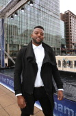 Star Oritse Williams attends a photocall to launch WaterAid's 'watergraphs' for World Water Day at Canary Wharf on March 19 2014 in London England
