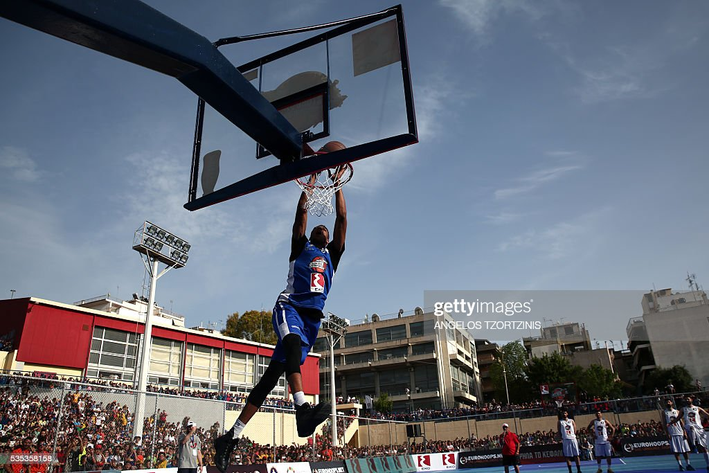NBA star player Giannis Antetokounmpo of the Milwaukee Bucks jumps to score during a game of streetball in Athens on May 29, 2016. The Antetokounbros Streetball Event organized by Eurohoops and the City of Athens, took place in an open court and was watched by 5,000 people. / AFP / ANGELOS