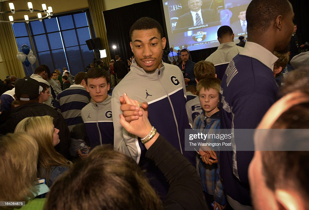 Star player Otto Porter greets fans after members of Georgetown's mens basketball team watch the NCAA tournament selection show on March, 17, 2013 in Washington, DC.