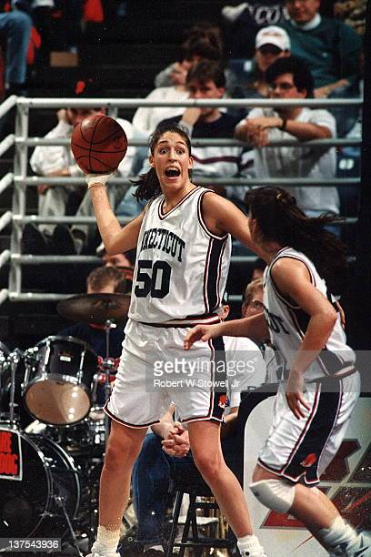 Star player Rebecca Lobo of the University of Connecticut women's basketball team grabs a rebound and looks to pass against Georgetown Storrs CT 1996