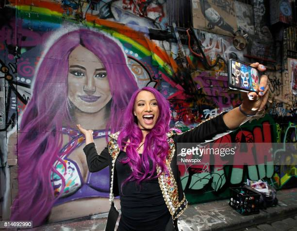 MELBOURNE VIC WWE star Sasha Banks poses with her portrait by Maha at Hosier Lane in Melbourne Victoria