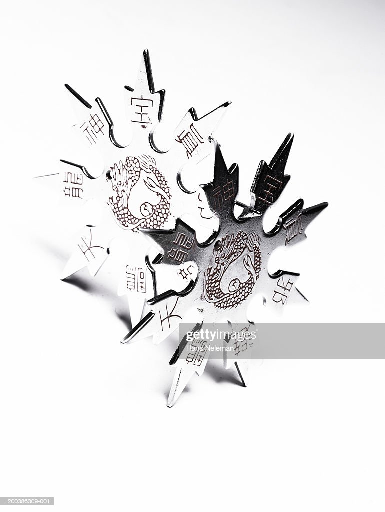 Star shape martial arts weapon, overhead view, close-up : Stock Photo