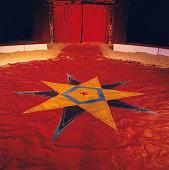 Star shape on circus tent floor