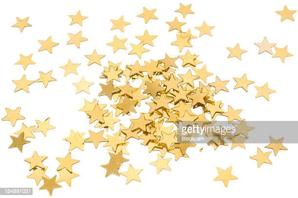 Star shaped golden confetti on white