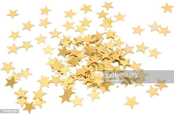Sternförmiges goldene Konfetti auf Weiß