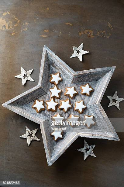 Star shaped wood bowl with cinnamon stars