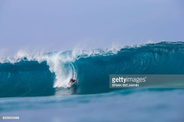 Star surfer Kelly Slater from the US surfs a perfect barrel during the 2017 Volcom Pipe pro at Pipeline February 4 on the North shore of Oahu Island...