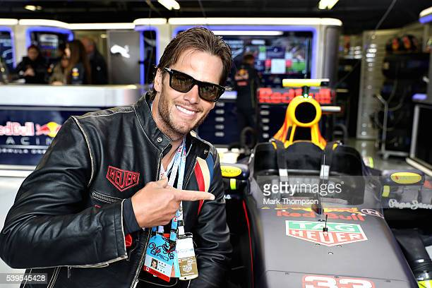 NFL star Tom Brady at the Red Bull Racing garage ahead of the Canadian Formula One Grand Prix at Circuit Gilles Villeneuve on June 12 2016 in...