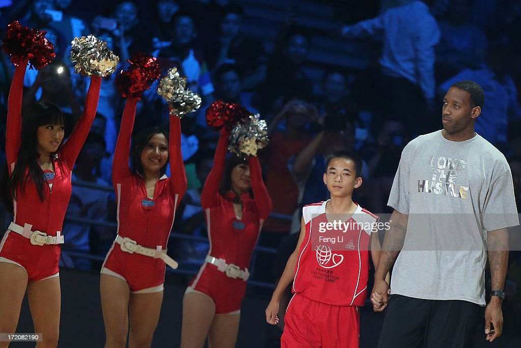 NBA star Tracy McGrady (R) attends the 2013 Yao Foundation Charity Game between China team and the NBA Stars team on July 1, 2013 in Beijing, China.