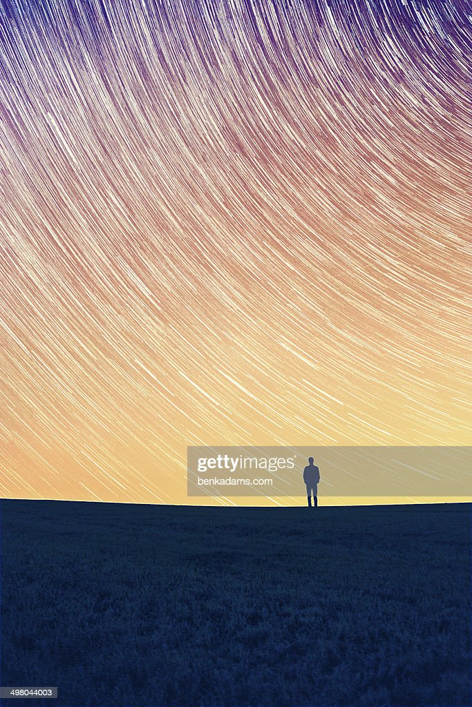 Star Trail - A man stood alone. : Stock Photo