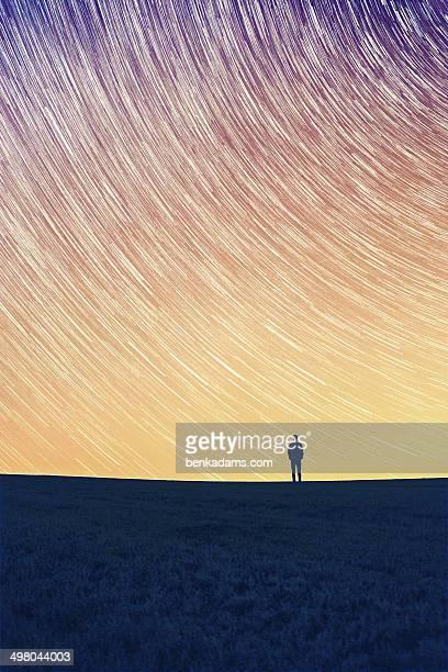 Star Trail - A man stood alone.