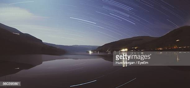 Star Trails Over Calm Lake At Night