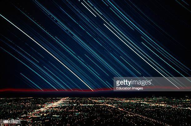Star Trails Over City