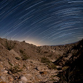 Star trails over one of the many rugged canyons in the Santa Rosa Mountains. Anza Borrego Desert State Park, California.