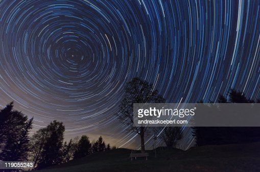 Star Trails with tree and bench in foreground