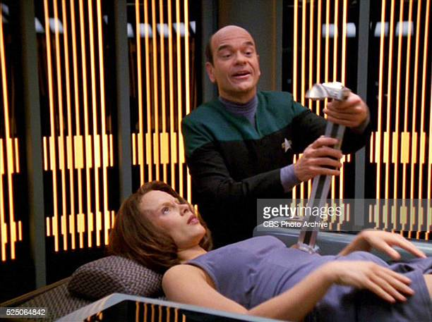 Star Trek Voyager episode 'Lineage' featuring Roxann Dawson as Lieutenant B'Elanna Torres and Robert Picardo as The Doctor In Sickbay the Doctor...