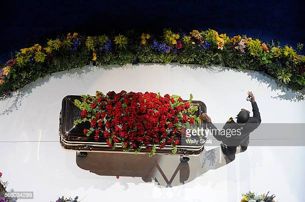 RB star Usher rests his hand of Michael Jackson's coffin during his rendition of Michael Jackson's 'Gone Too Soon' during Michael Jackson memorial at...