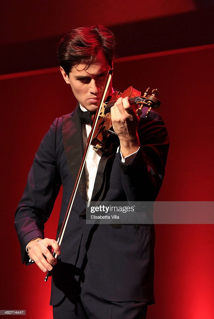 Star violinist Charlie Siem performs on stage during The Children For Peace Benefit Gala Ceremony at Spazio Novecento on November 30, 2013 in Rome, Italy.