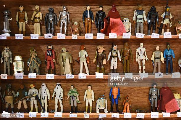 Star Wars action figures are displayed for sale on a stall selling merchandise during the unofficial Star Wars convention 'For the Love of the Force'...