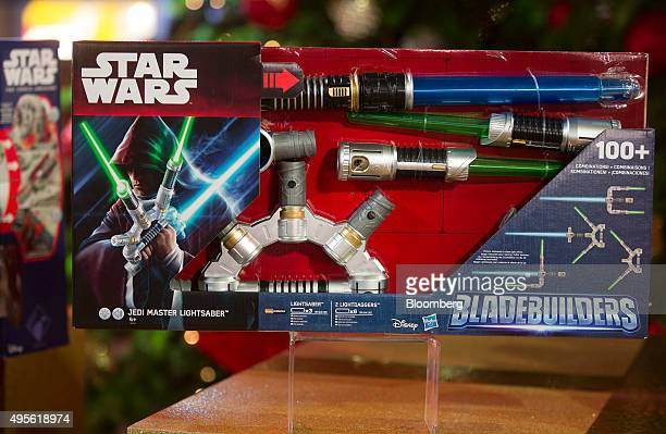 A Star Wars Bladebuilders Jedi Master Lightsaber manufactured by Hasbro Inc sits on display at the Toy Retailers Association DreamToys 2015 event in...
