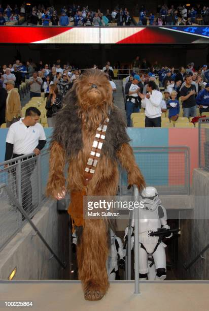 Star Wars character Chewbacca and Stormtroopers enter Dodger Stadium prior to throwing out the ceremonial first pitch to celebrate the 30th...