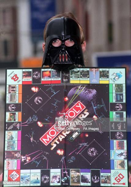 Star Wars character 'Darth Vader' holds up the limited edition version of the popular board game Monopoly In its first revamp in 62 years the board...