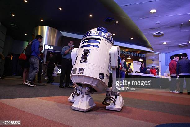 Star Wars character R2 D2 interacts and poses for pictures during the Star Wars celebration in Pasay City Star Wars will be releasing it's latest...