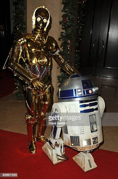 Star Wars characters C3PO and R2D2 arrive at the 23rd Annual American Cinematheque Awards held at the Beverly Hilton on December 1 2008 in Beverly...