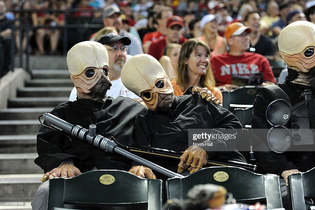 Star Wars characters Figrin D'an and the Modal Nodes sit in the stands during a game between the Arizona Diamondbacks and the Cincinnati Reds at Chase Field on June 23, 2013 in Phoenix, Arizona.