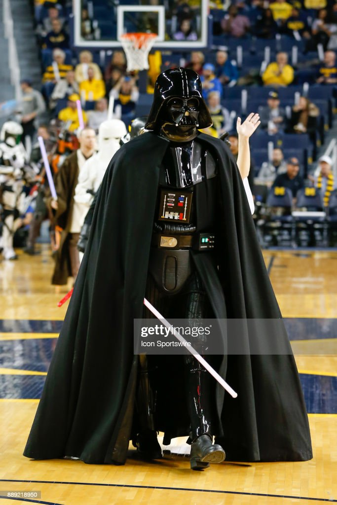 Star Wars characters leave the court during pregame ceremonies before the start of a regular season non-conference basketball game between the UCLA Bruins and the Michigan Wolverines on December 9, 2017 at the Crisler Center in Ann Arbor, Michigan. Michigan defeated UCLA 78-69 in overtime.
