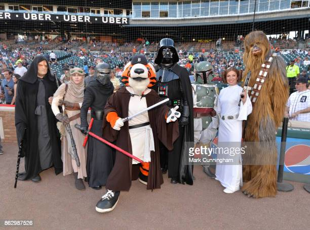 Star Wars characters pose for a photo on the field with the Detroit Tigers mascot Paws prior to the Star Wars Night game between the Detroit Tigers...