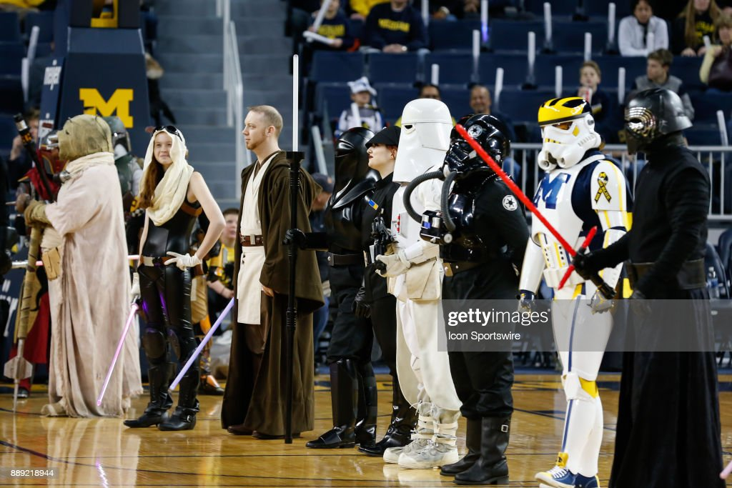 Star Wars characters stand on the court during pregame ceremonies before the start of a regular season non-conference basketball game between the UCLA Bruins and the Michigan Wolverines on December 9, 2017 at the Crisler Center in Ann Arbor, Michigan. Michigan defeated UCLA 78-69 in overtime.