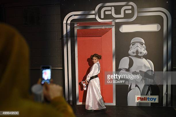 Star Wars fan Alisha aged 10 dressed as Princess Leia has her photograph taken whilst posing in a giant replica of a toy display box for a...