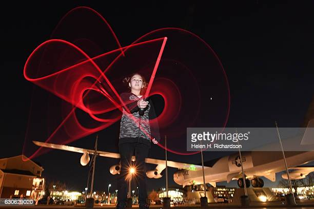 'Star Wars' fan Hazel Ramirez swings her light saber around outside of the Wings Over the Rockies museum on December 28 2016 in Denver Colorado A...