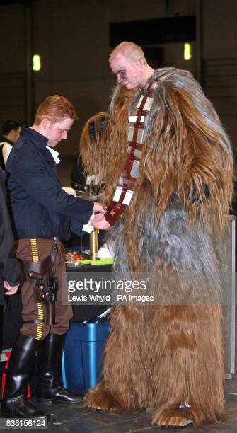 A Star Wars fan is helped into his 'Chewy' costume at the Star Wars Convention in the Excel Centre London