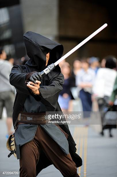 Star Wars fans pose in character costumes in Tokyo Japan during the Star War Day on May 4 2015