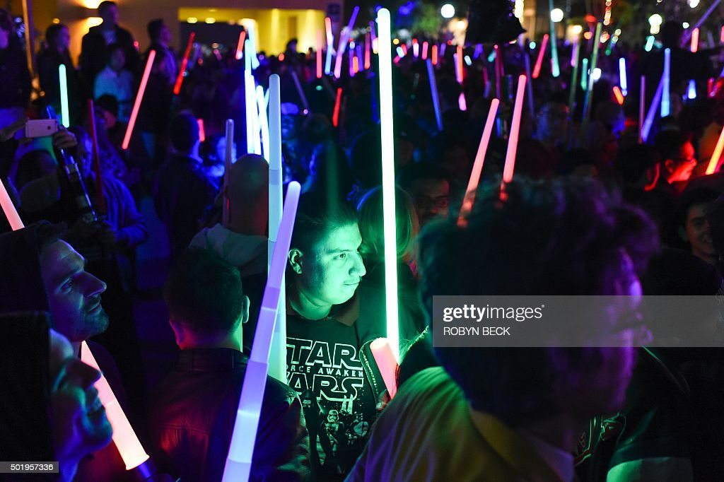 Star Wars fans raise their lightsabers during Lightsaber Battle LA in Pershing Square in downtown Los Angeles California on December 18 2015 'Star...