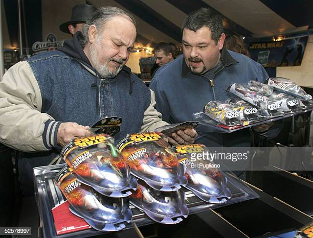 Star Wars fans Richard Callante and Matt Hamilton both of Rochester Hills Michigan examine newly released Star Wars toys and merchandise at a special...