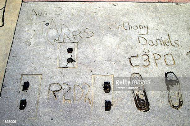 'Star Wars' robots R2D2 C3PO and Anthony Daniels's prints are seen outside Grauman's Chinese Theatre on March 16 2003 in Hollywood California
