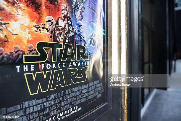 A 'Star Wars The Force Awakens' advertisement is seen outside the Ziegfeld theater on December 11 2015 in New York City Disney acquired Lucasfilm...
