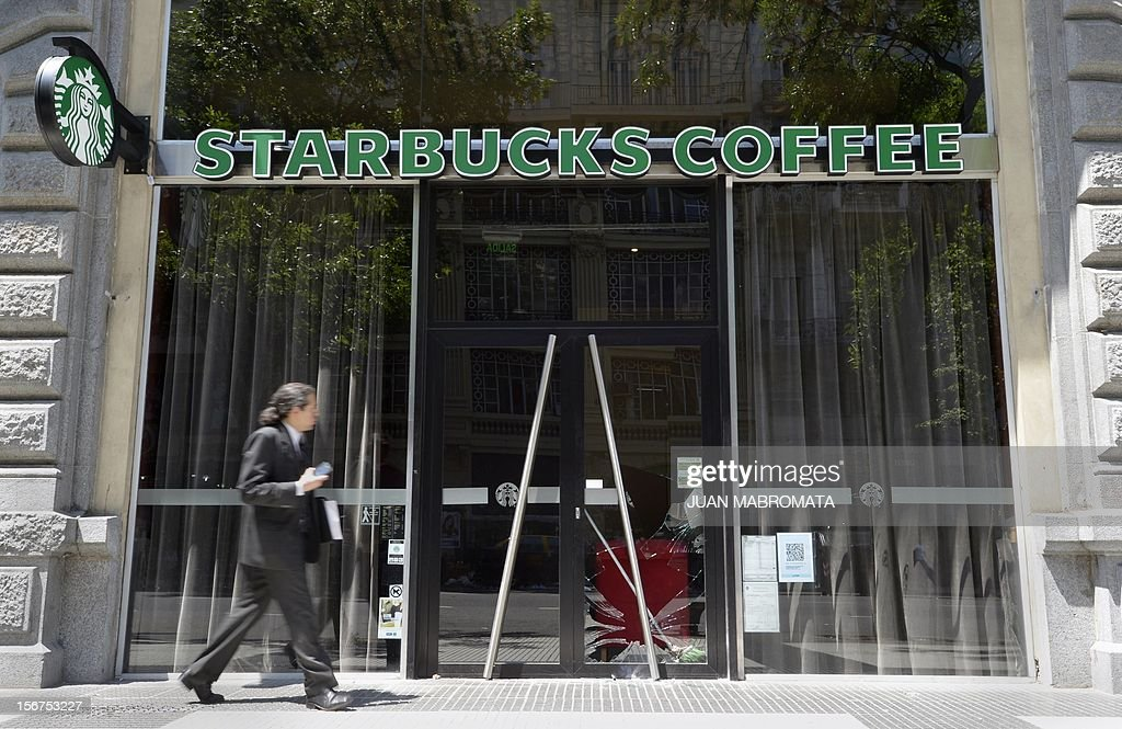 A Starbucks Coffee bar remains closed after demonstrators broke its glass door during a unions' strike that blocks the approaches to the capital, on November 20, 2012 in Buenos Aires. A general strike was called Tuesday by the working unions opposing the government of President Cristina Fernandez de Kirchner to protest against the taxes on wages. AFP PHOTO / Juan Mabromata
