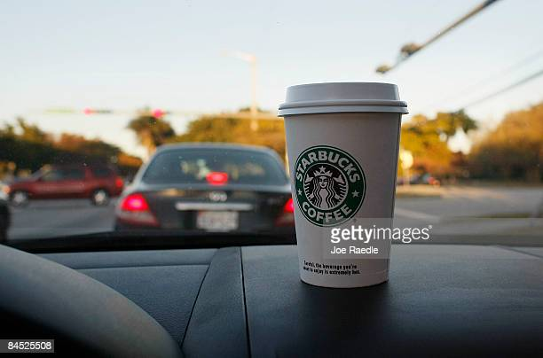 Starbucks Coffee cup is shown January 28 2009 in Miami Florida Starbucks will lay off about 700 nonstore workers by midFebruary including about 350...
