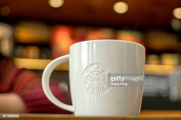 Starbucks coffee cup on table At the end of November a Chinese customer posted an open letter online to the chief executive of Starbucks in China to...