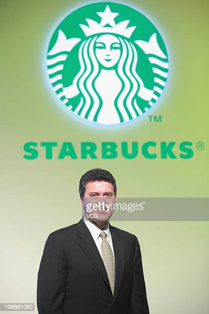 Starbucks Coffee International president John Culver attends a press conference to unveil their new logo at the China World Summit Wing on March 08...