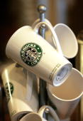 Starbucks coffee mugs are displayed for sale at a Starbucks store October 3 2006 in Park Ridge Illinois On October 3 2006 Starbucks raised their...